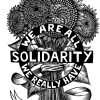 black and white artwork of a bunch of sunflowers tied together by a ribbon. A black circle is front of the flowers and reads in all caps WE ARE ALL WE REALLY HAVE. There is a black bar across the front of the circle that reads in all caps SOLIDARITY